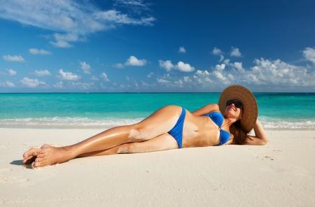 sexy beach girl: Woman in bikini at tropical beach Stock Photo