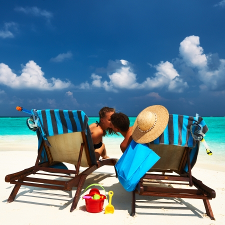 beach kiss: Couple on a tropical beach at Maldives