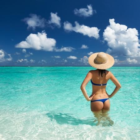 Woman in bikini at tropical beach Stock Photo