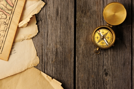 Antique brass compass over wooden background Stock Photo - 19146796