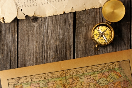 Antique brass compass over old map Stock Photo - 19146799