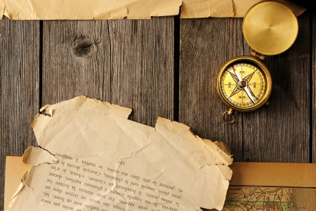 Antique brass compass over old map Stock Photo - 19135546