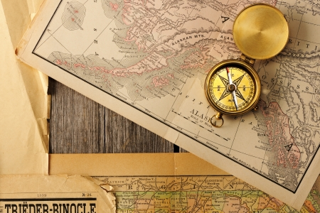 Antique brass compass over old map Stock Photo - 19146791