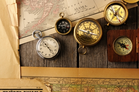 Antique brass compasses over old map Stock Photo - 19146749