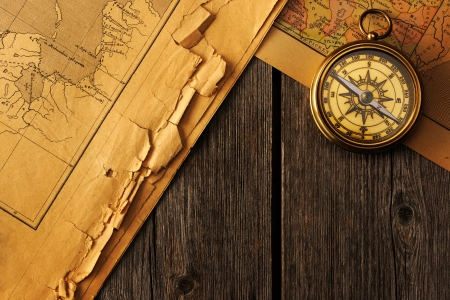 Antique brass compass over old map Stock Photo - 19146794