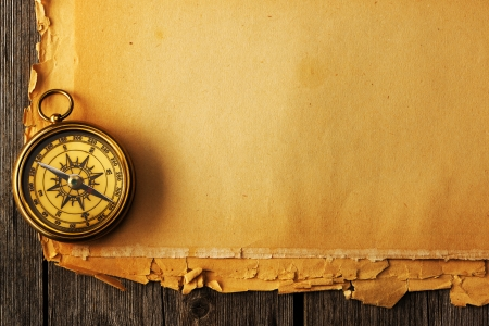 Antique brass compass over old paper background Stock Photo - 19146793
