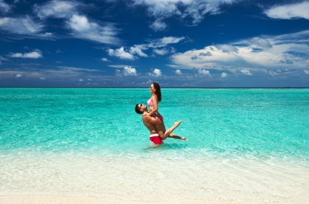 Couple on a tropical beach at Maldives photo