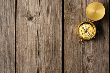 Antique brass compass over wooden background Stock Photo - 19358855