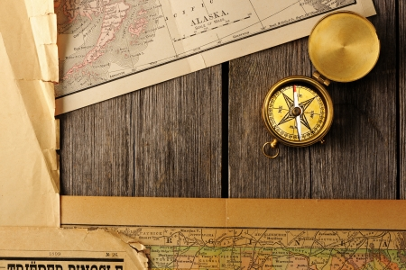 Antique brass compass over old map Stock Photo - 19358841