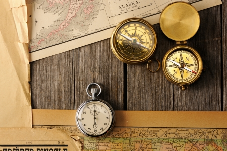 Antique brass compasses over old map photo