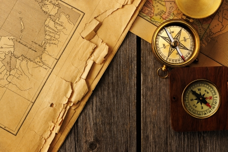 Antique brass compass over old map Stock Photo - 19358839