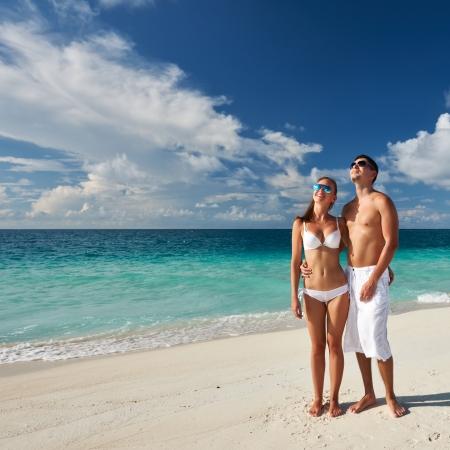 sunglasses beach: Couple on a tropical beach at Maldives