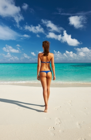 thong bikini: Woman in bikini at tropical beach Stock Photo