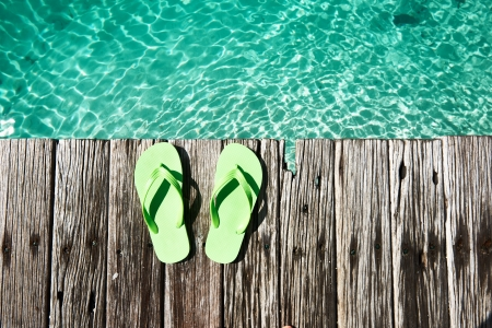 Slippers at jetty by the sea photo