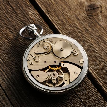 clockwork: Clockwork mechanism over wooden background  Stock Photo