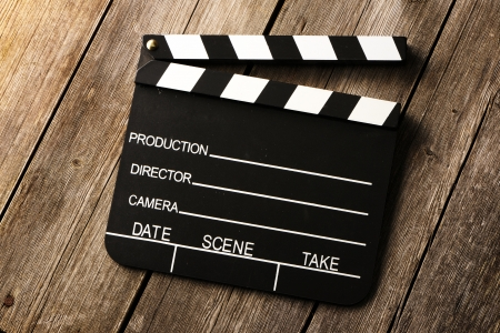 clapper board: Movie production clapper board over wooden background Stock Photo