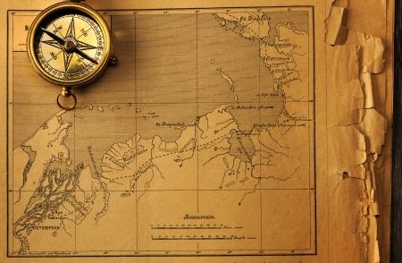 brass: Antique brass compass over old map