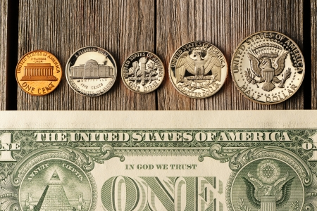 New uncirculated US money over wooden background photo