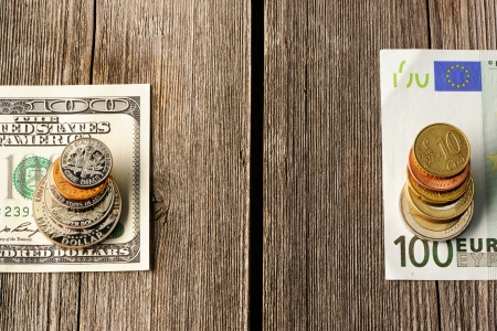 US and euro currency over wooden background photo