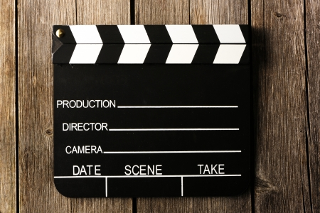 movie clapper: Movie production clapper board over wooden background Stock Photo