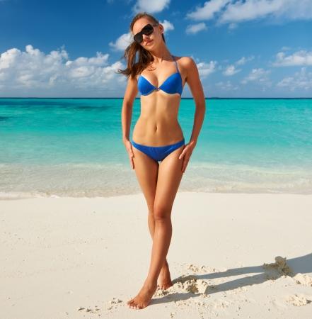 blue bikini: Woman in bikini at tropical beach Stock Photo