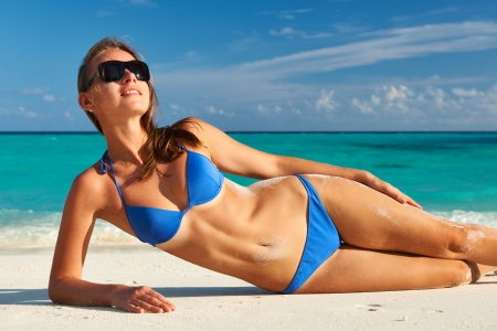 bikini island: Woman in bikini at tropical beach Stock Photo