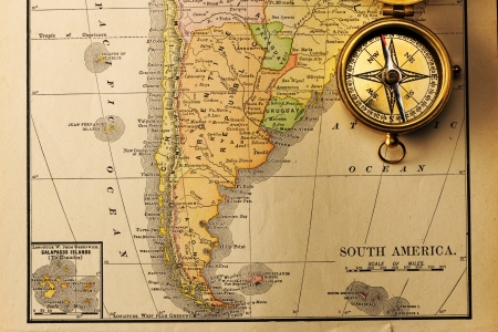south america map: Antique brass compass over old XIX century map