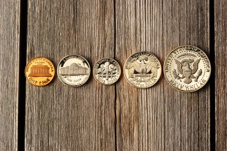 half cent: Five US cent coins over wooden background Stock Photo