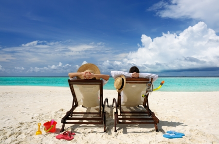 summer vacation: Couple on a tropical beach at Maldives