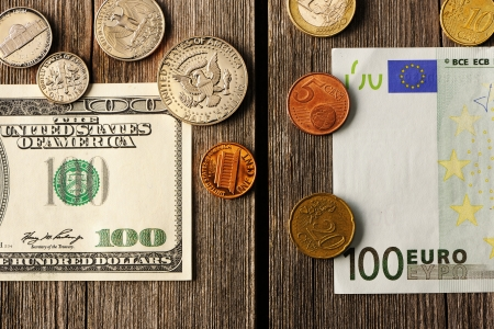 uncirculated: US and euro currency over wooden background Stock Photo