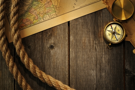 nautical compass: Antique brass compass and rope over old map Stock Photo