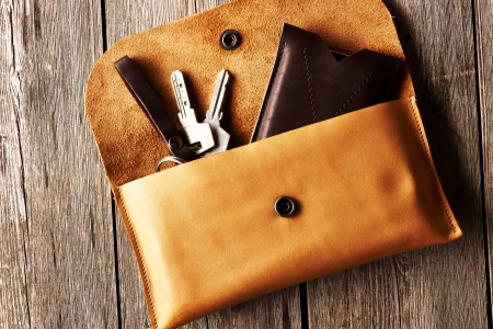 d i y: Handmade leather product over wooden background Stock Photo