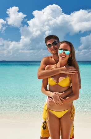 Couple on a tropical beach at Maldives Stock Photo - 20623029