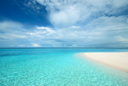 Crystal clear turquoise water at tropical maldivian beach photo