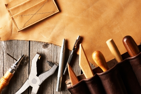 leather background: Leather crafting tools still life