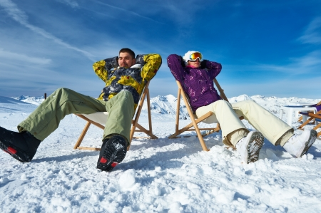 Couple at mountains in winter, Meribel, Alps, France photo