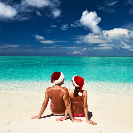 Couple in santas hat on a tropical beach at Maldives photo