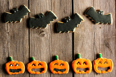 Halloween homemade gingerbread cookies over wooden table Stock Photo