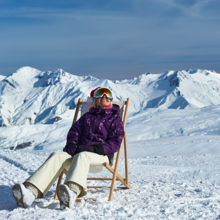 Woman at mountains in Santa hat celebrating christmas, Meribel, Alps, France photo