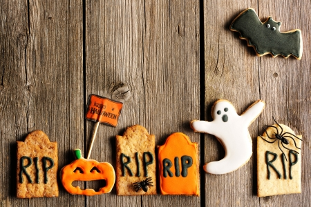 dessert: Halloween homemade gingerbread cookies over wooden table Stock Photo