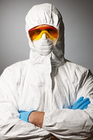 Scientist in protective wear, glasses and respirator  photo