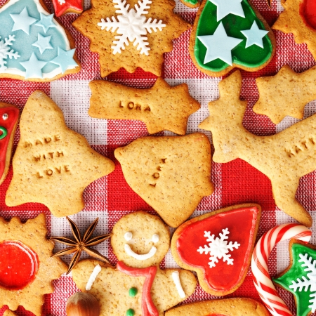 Christmas gingerbread cookies over tablecloth photo