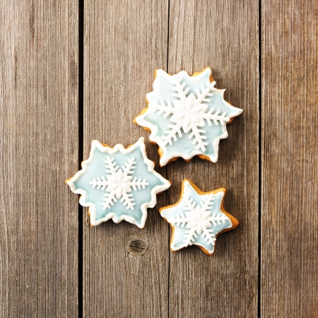 Christmas homemade gingerbread cookie over wooden table Stock Photo - 22855292