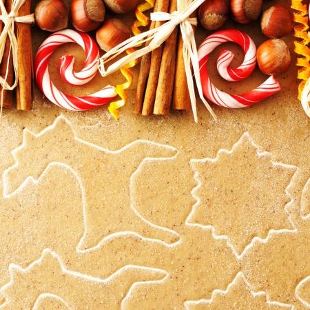 Christmas spices over homemade gingerbread dough photo
