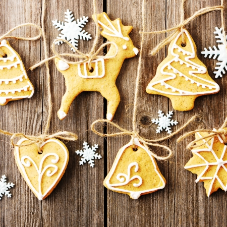 Christmas homemade gingerbread cookies over wooden table Stock Photo - 22855300