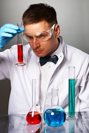 Scientist in protective glasses at laboratory Stock Photo - 22847445
