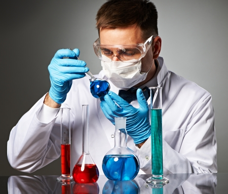 Scientist in protective glasses at laboratory photo