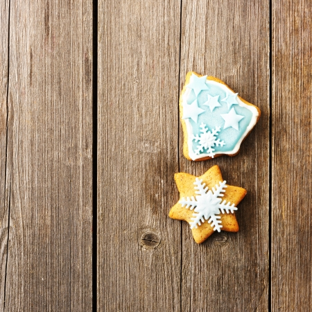 Christmas homemade gingerbread cookie over wooden table Stock Photo - 23093068