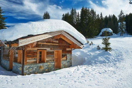 chalet: Mountain ski resort with snow in winter, Courchevel, Alps, France