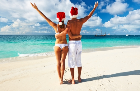 Couple in santa's hat on a tropical beach at Maldives Stock Photo - 23092823